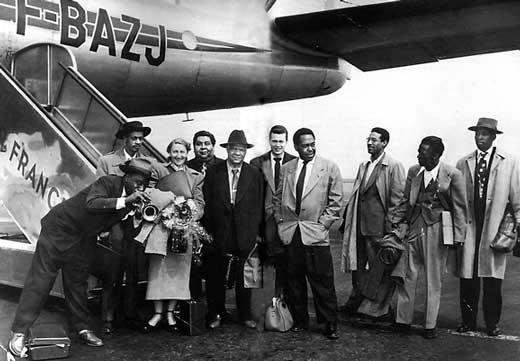 Hot Lips Page, Tommy Potter, Agent, Big Chief Moore, Sidney Bechet, Al Haig, Charlie Parker, Max Roach, Miles Davis, Kenny Dorham (Paris 1949)